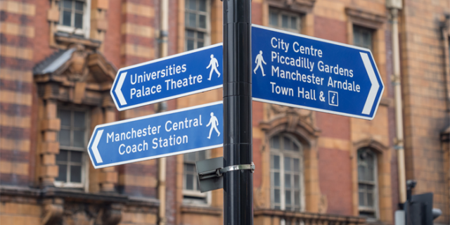 Signpost pointing towards the University of Manchester