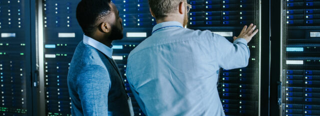 Two multi-cloud experts in a secure data centre