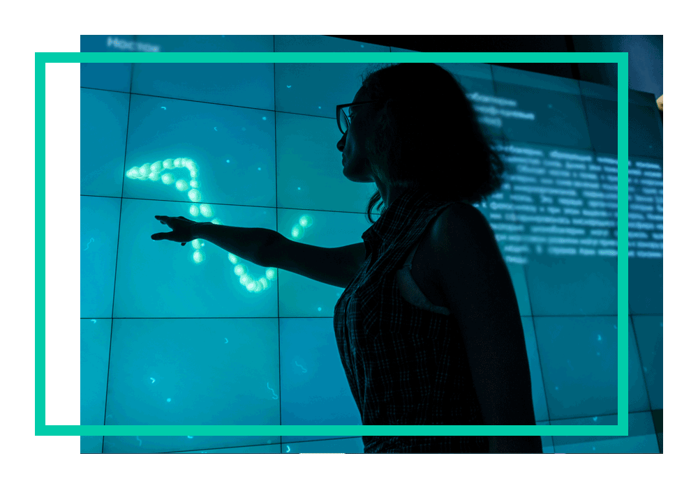 A woman looking at cloud data on a screen