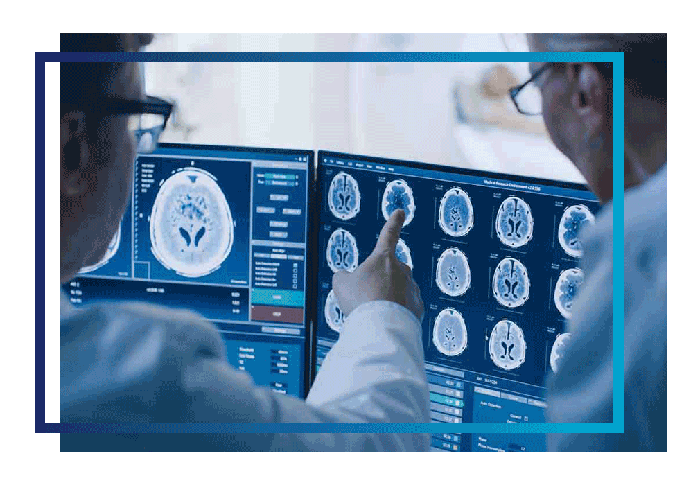Two doctors looking at cloud-enabled medical imaging
