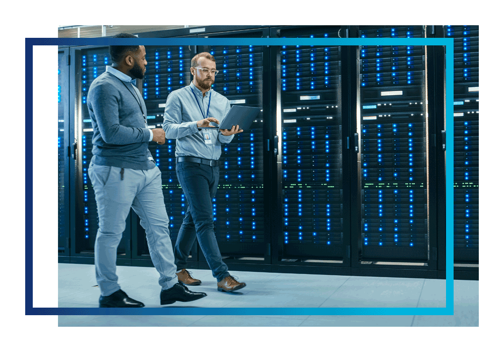 Two multi-cloud experts walking in a secure datacentre
