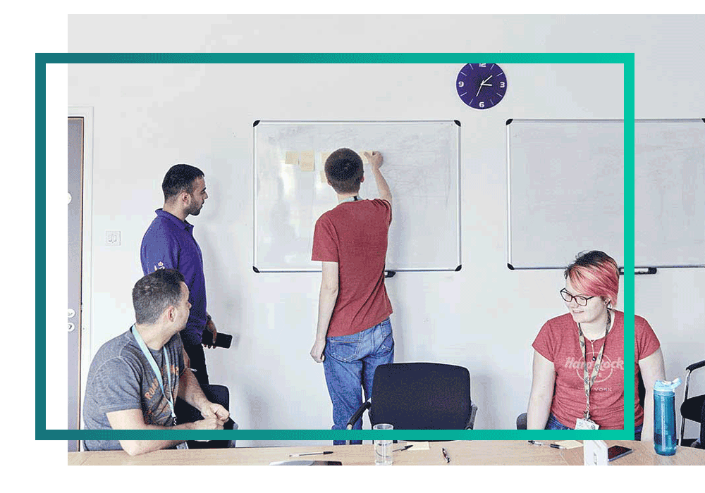 Team of multi-cloud experts working on a whiteboard