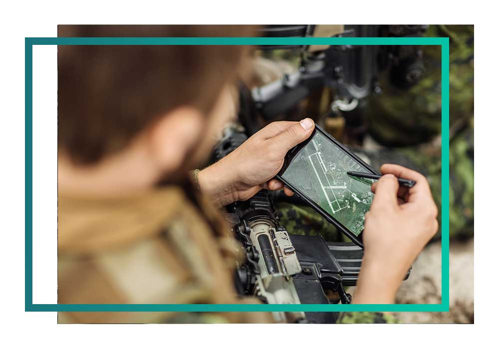 A solider using a hand-held device
